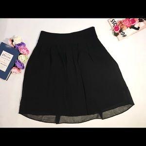 Ann Taylor mini black pleaded skirt size 2 party